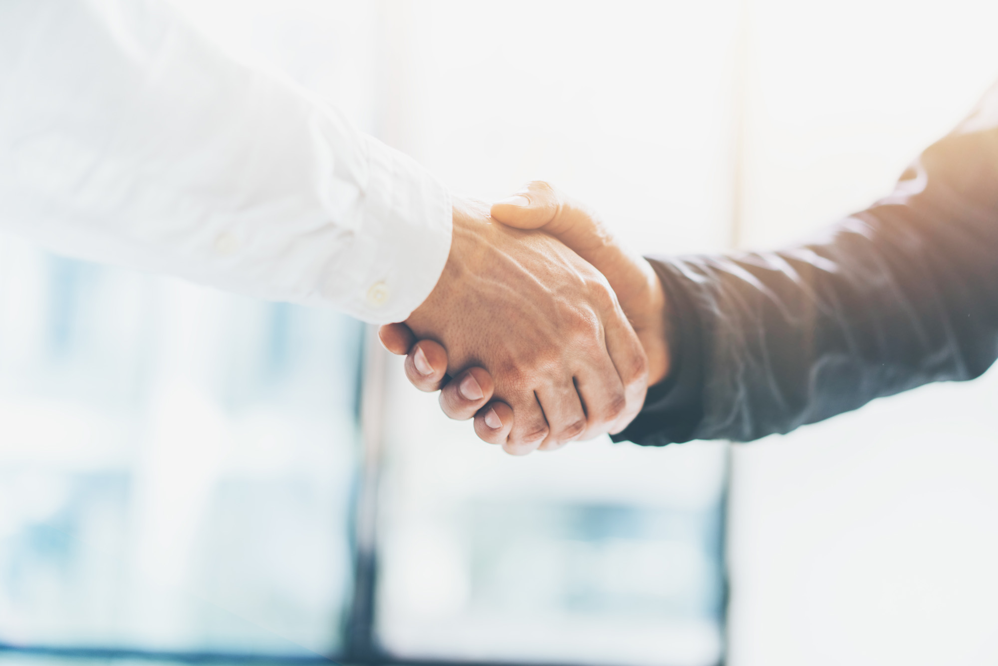 Business partnership meeting. Picture businessmans handshake. Successful businessmen handshaking after good deal. Horizontal, blurred